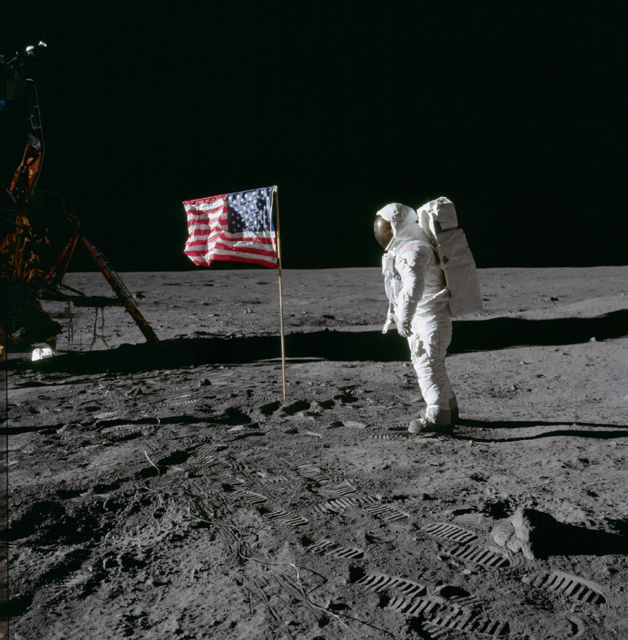 Astronaut Buzz Aldrin beside US flag © NASA