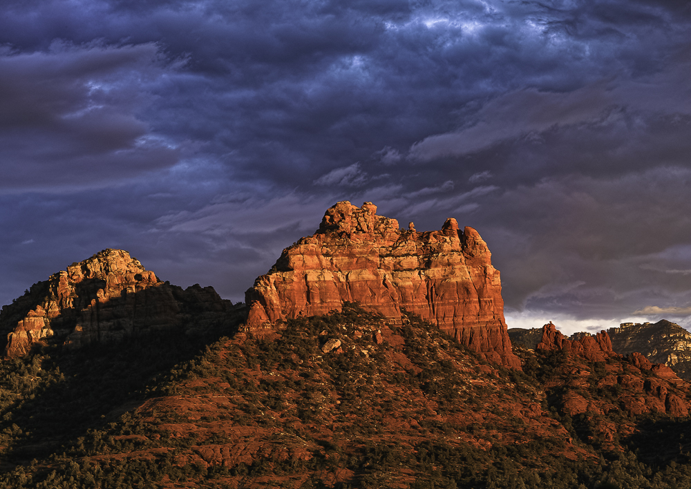 Sunsets on Sedona red rocks as storm clouds gather