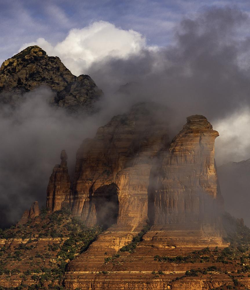 Morning sun illuminates Coffeepot Rock as fog lifts