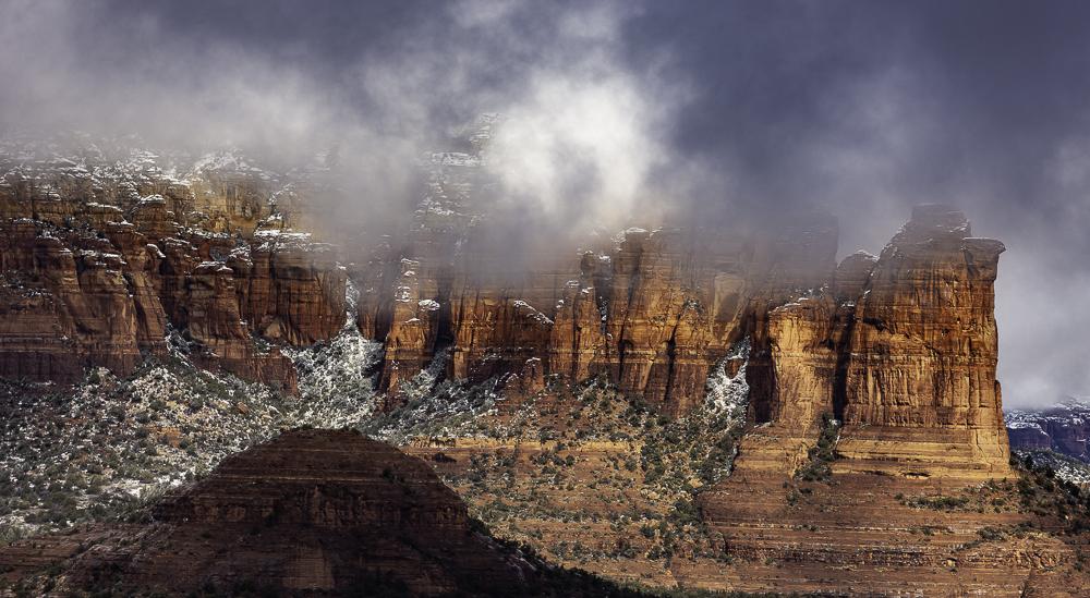 Bright mist swirls above Coffeepot formation