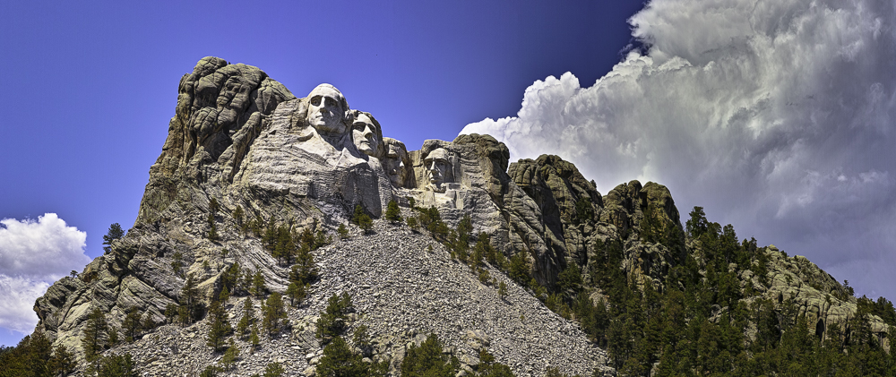 Mount Rushmore and huge cumulus cloud on opposing diagonals