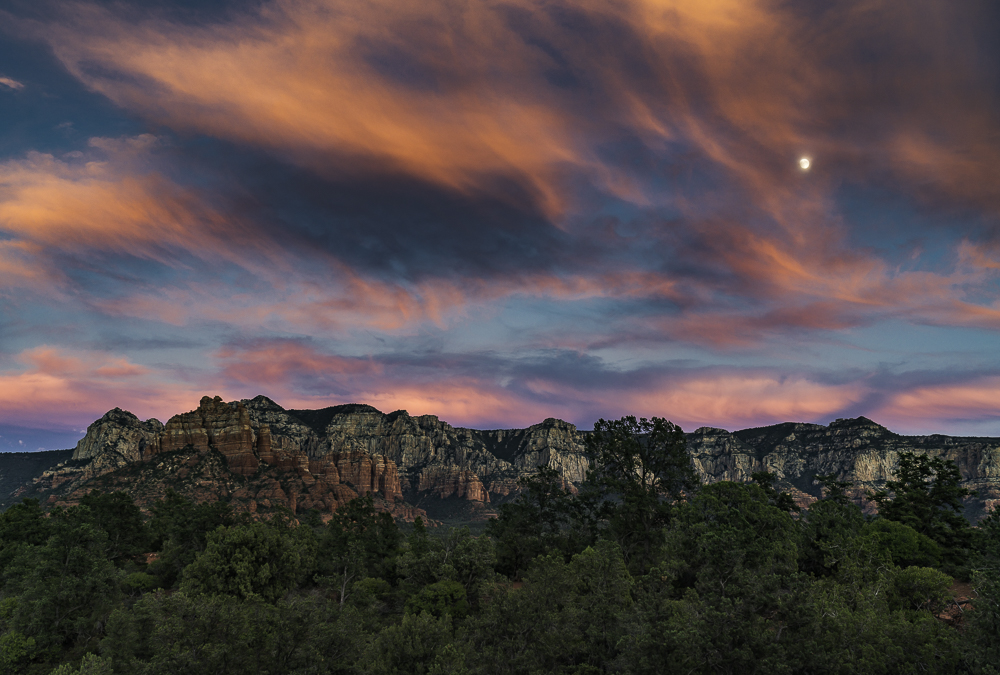 Wild red clouds and moonrise over the Mogollon Rim