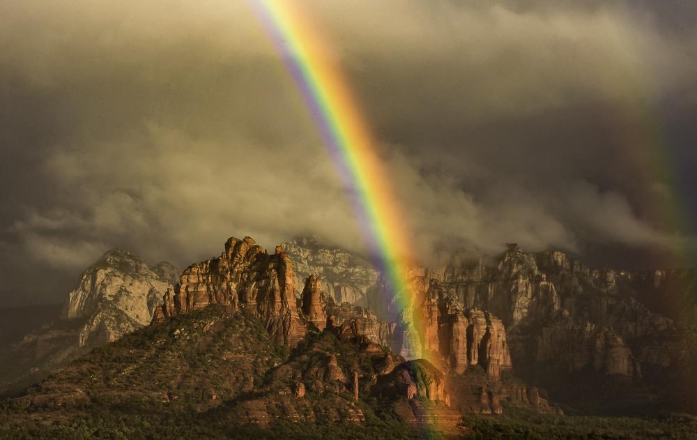 Brilliant rainbow marks the end of a storm, Sedona, AZ