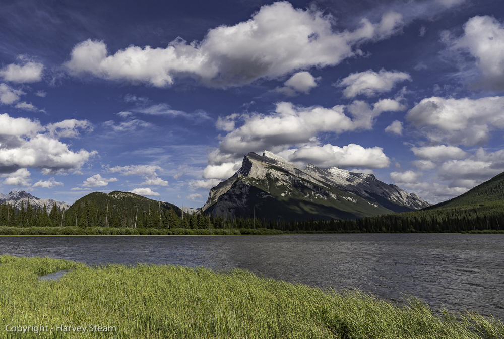 Wind-driven clouds move across the Canadian Rockies