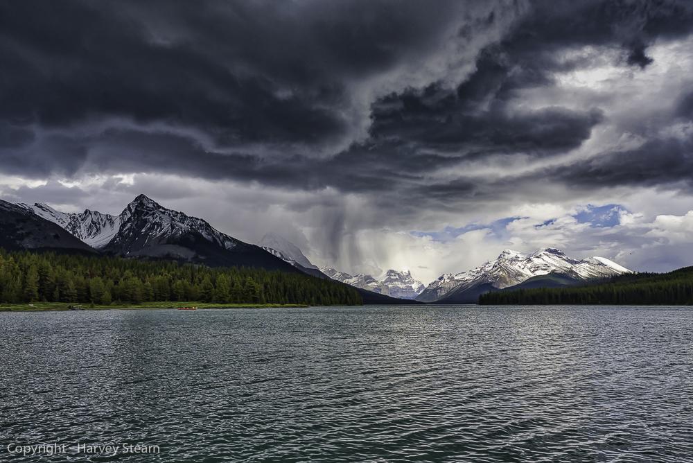 Rain storm passes over Maligne Lake in Jasper NP