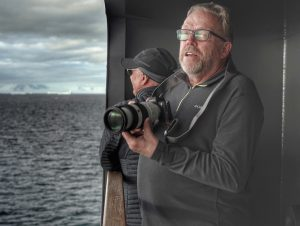Art Wolfe and Kevin Raber photographing the iceberg