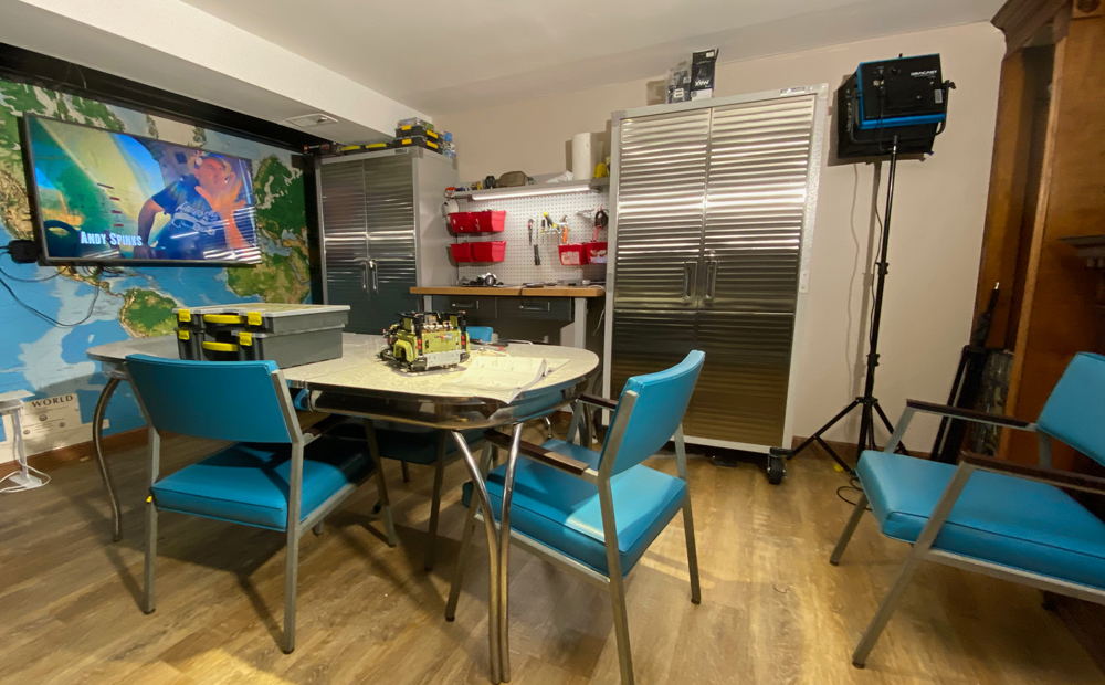 The work areas has a classic old heirloom kitchen table to do work on, a tTV on the wall for video previews or just watching show while working in the Man Cave.