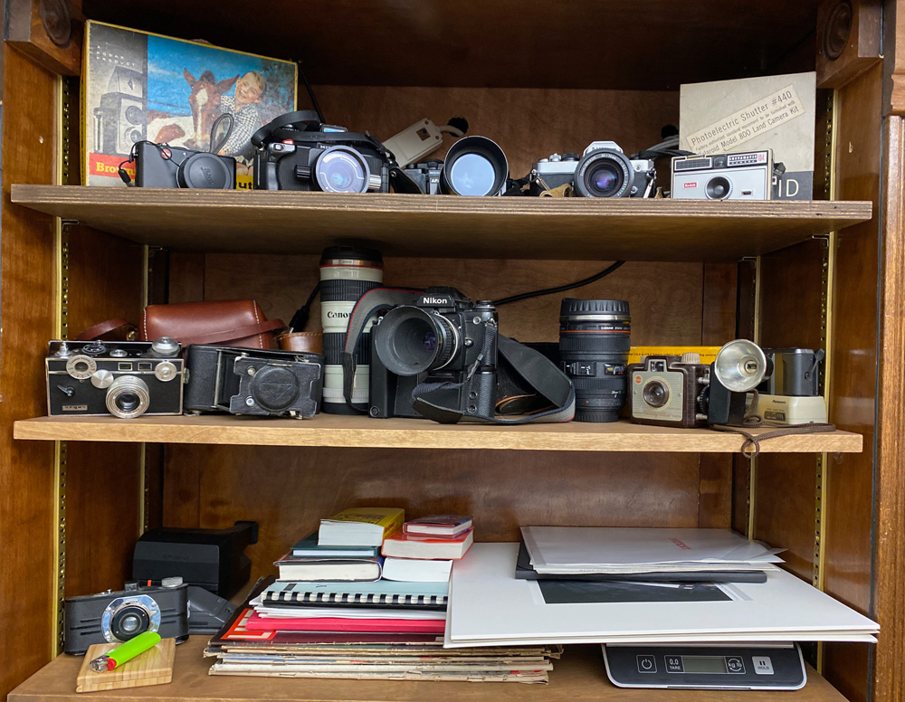 A small portion of my old camera collection as well as prints and books