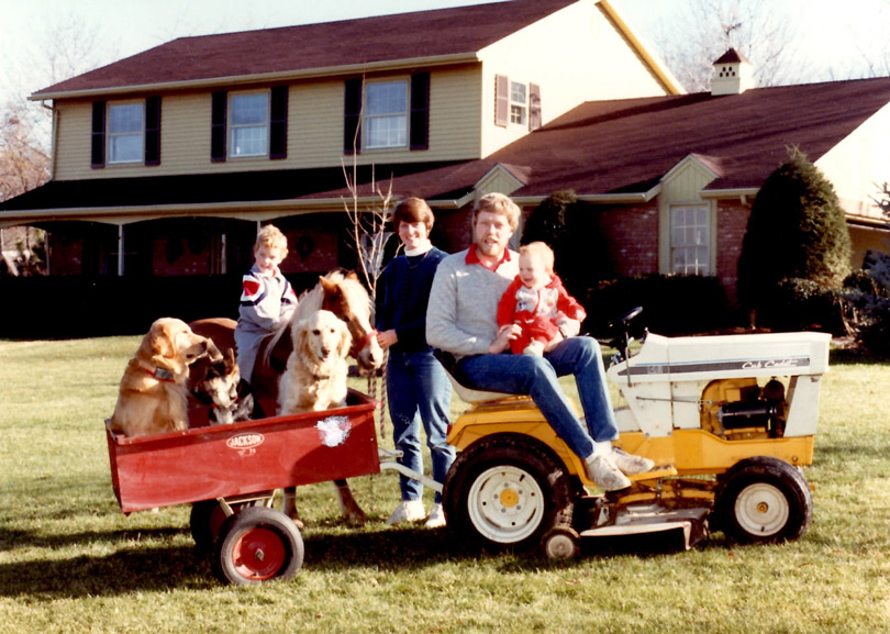 A family portrait from the 80's less one of my boys who wasn't born yet. Three dogs, one pony, my favorite tractor. Truly different times.
