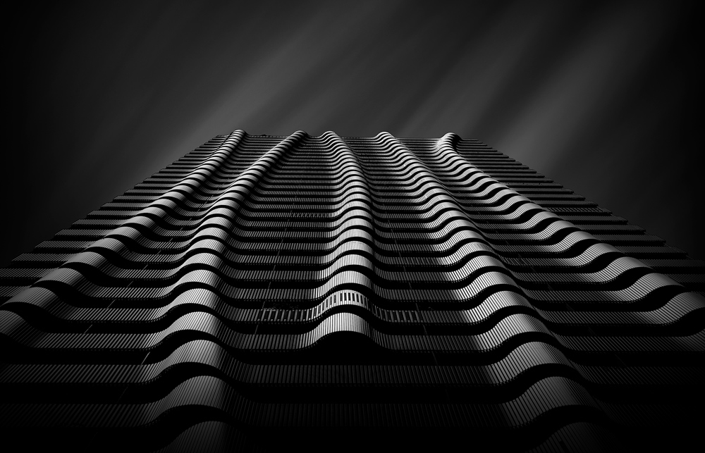 """Hans Wichmann (Germany) """"City Waves""""Skyscraper in Vienna / Austria.Photographed upwards with light from the side. Edited with hard contrasts in Photoshop. The sky was photographed separately and then inserted. https://hans-wichmann.myportfolio.com/"""