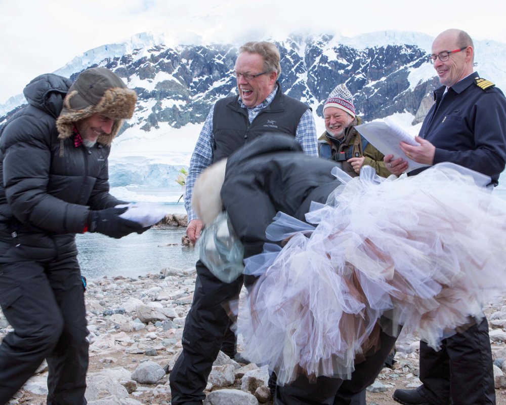 A friend of ours shared this image from our wedding in Antarctica this week. It makes us smile as few remember such a great day. Christian Fletcher our ring boy managed to drop our rings in penguin pooh. We had a good laugh. Michael Reichmann is seen in the background.