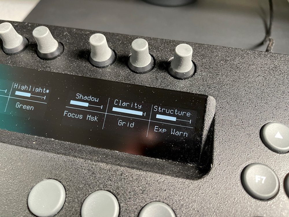 The third set of the top row of knobs and buttons> you can easily see the display readout.