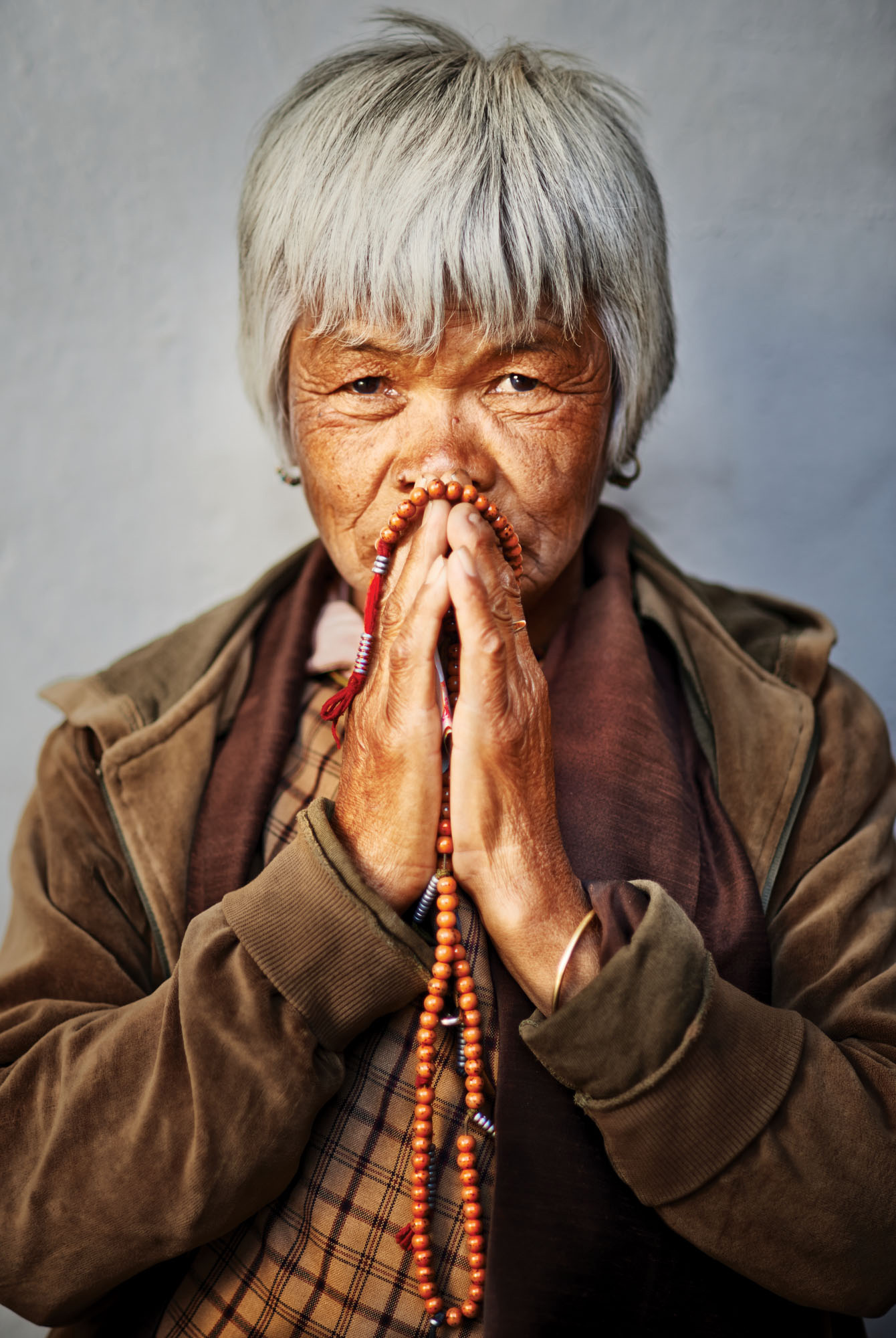 Lady praying, Bhutan. Should I have paid to take this photo? My conscience is clear! Nikon D800, 85mm lens, f2 @ 1/400 second, ISO 200.