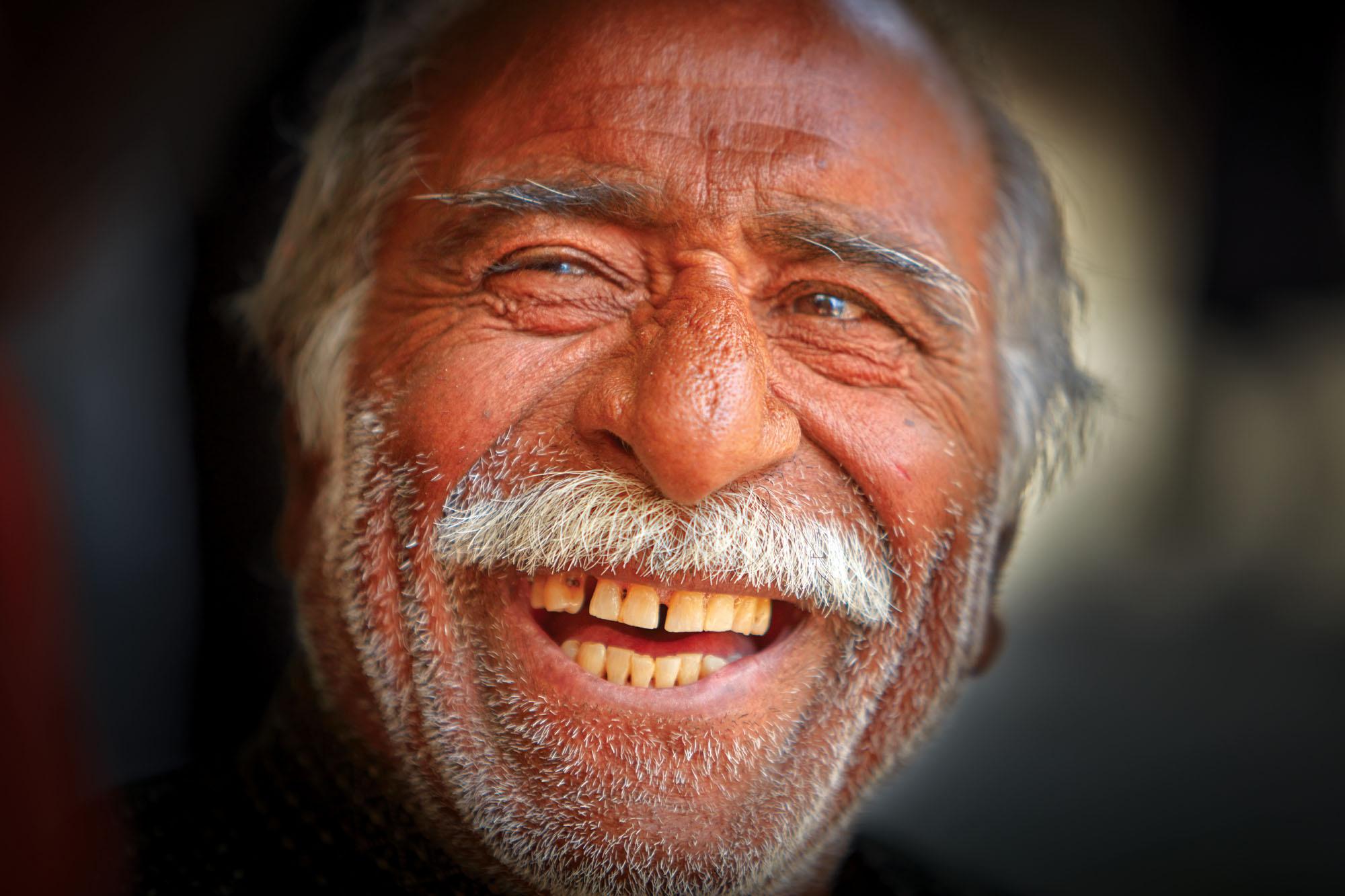 Musician and whistle salesman, Hamadan, Iran. Canon EOS 5DSR, Canon 70-200mm f2.8, f2.8 @ 1/250 second, ISO 200.