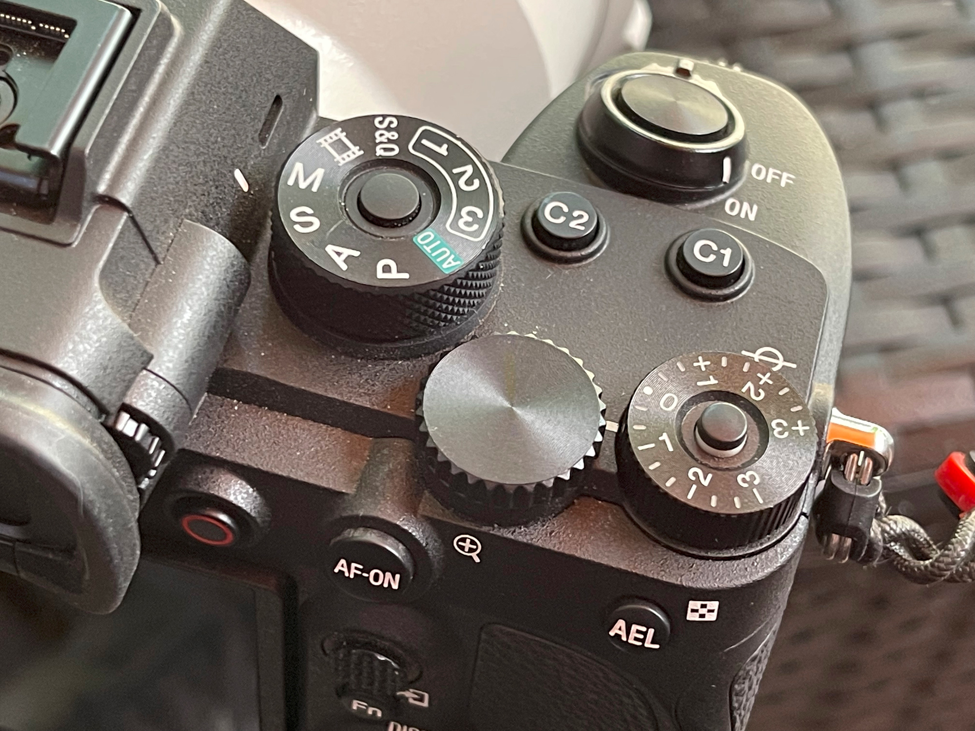 The right side of the camera. All controls are easy to reach and work.