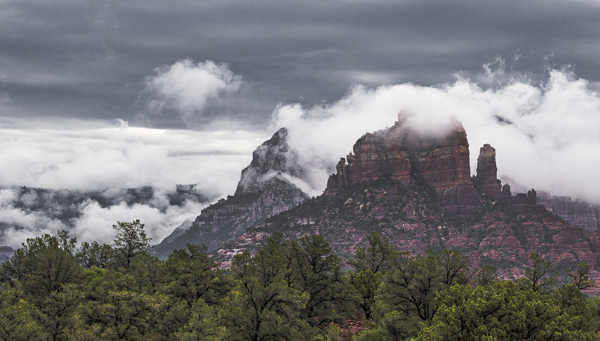 Monsoon Clouds Over the Crimson Cliffs