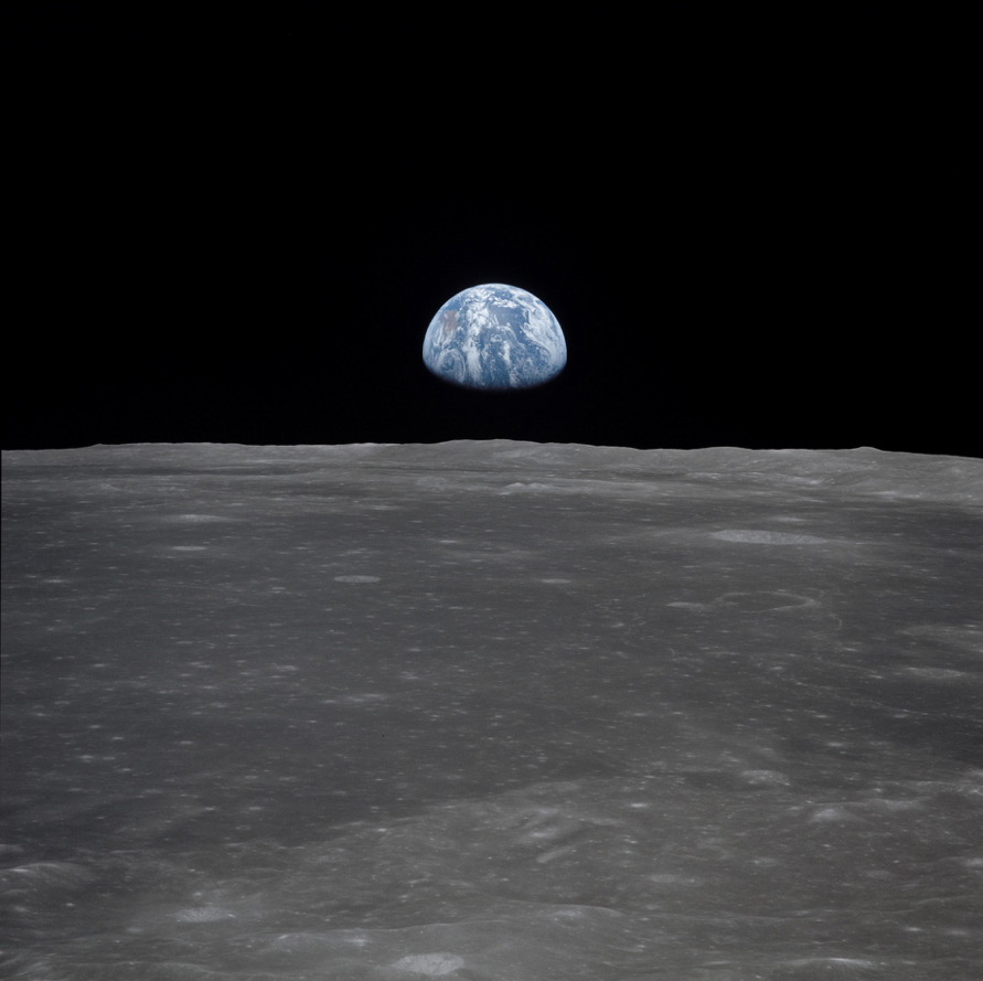 View of Earth rising over Moon's horizon taken from Apollo 11 spacecraft © NASA
