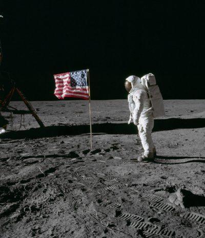 Astronaut Buzz Aldrin beside US flag © NASA
