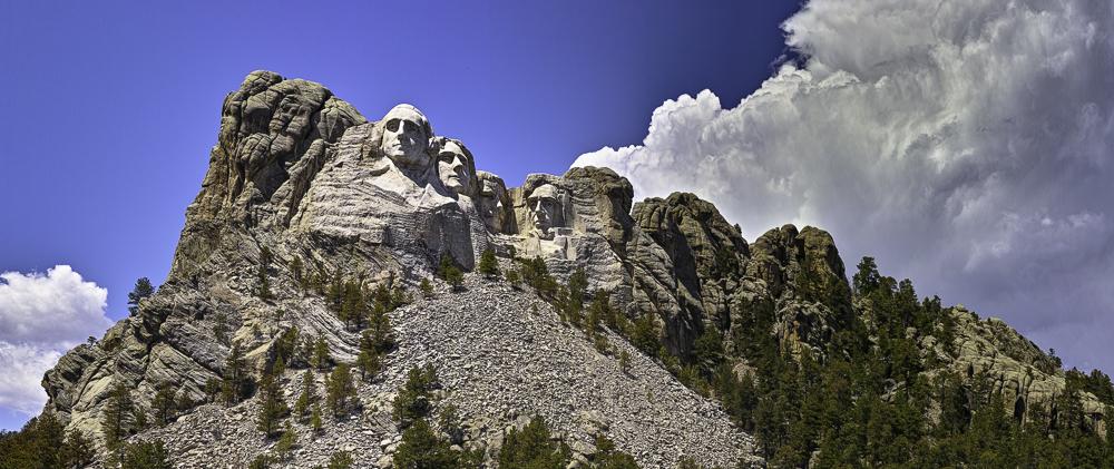 Mount Rushmore and huge cumulus cloud on opposing diagonals