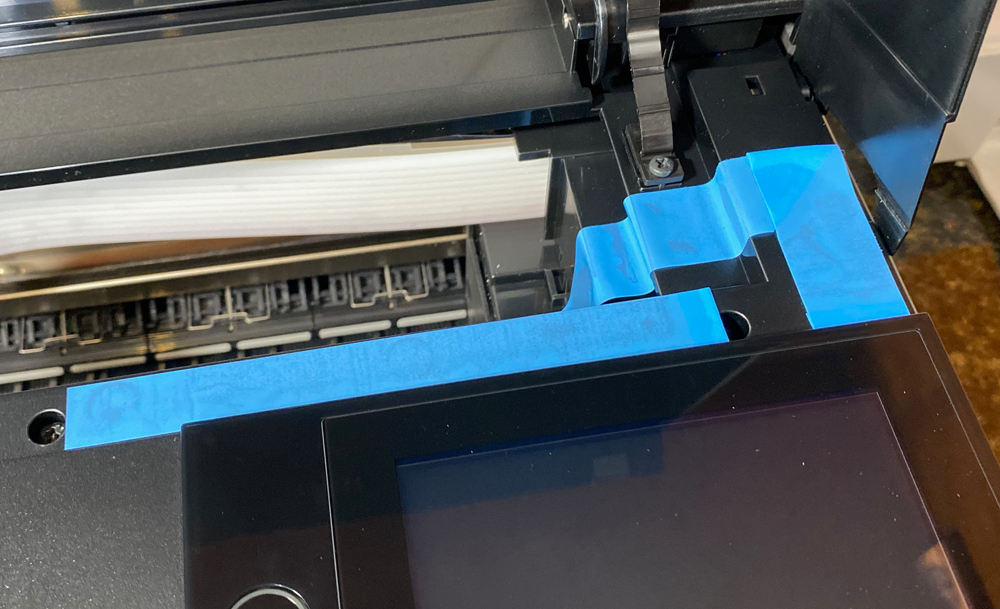 Epson blue tape. Lots of the tape is well hidden.