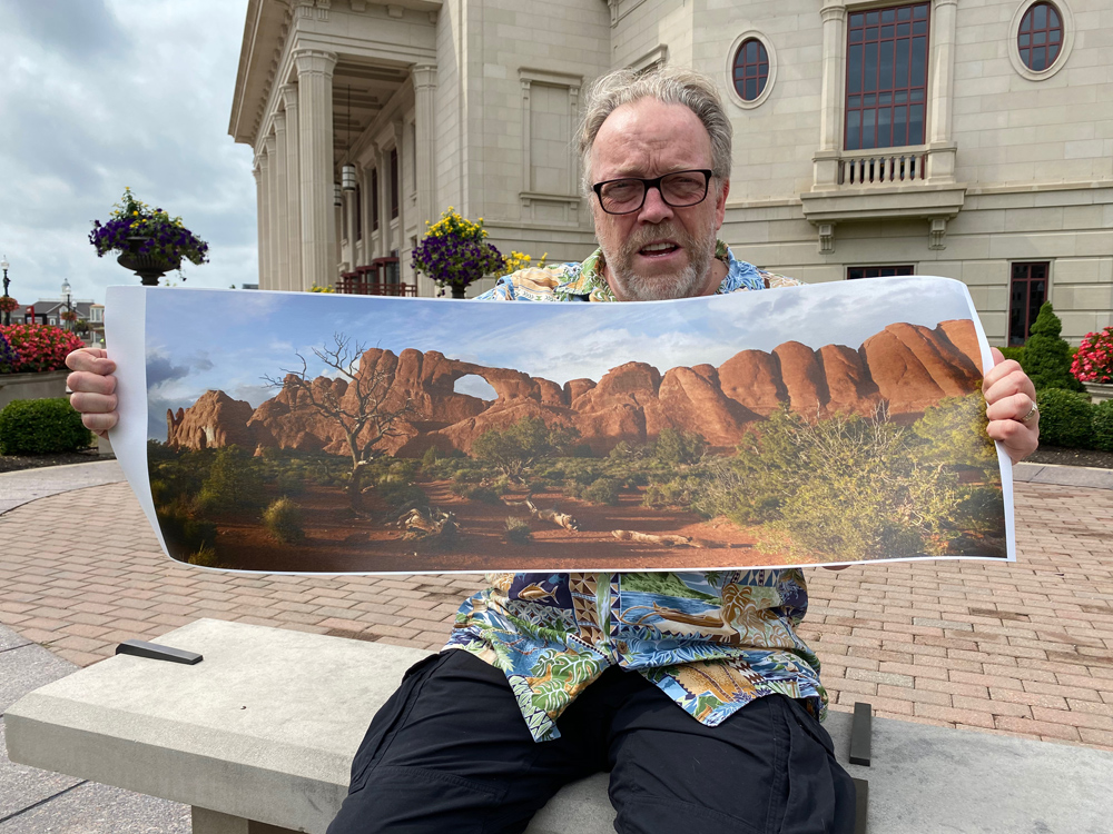 Me holding the final print, made on canvas