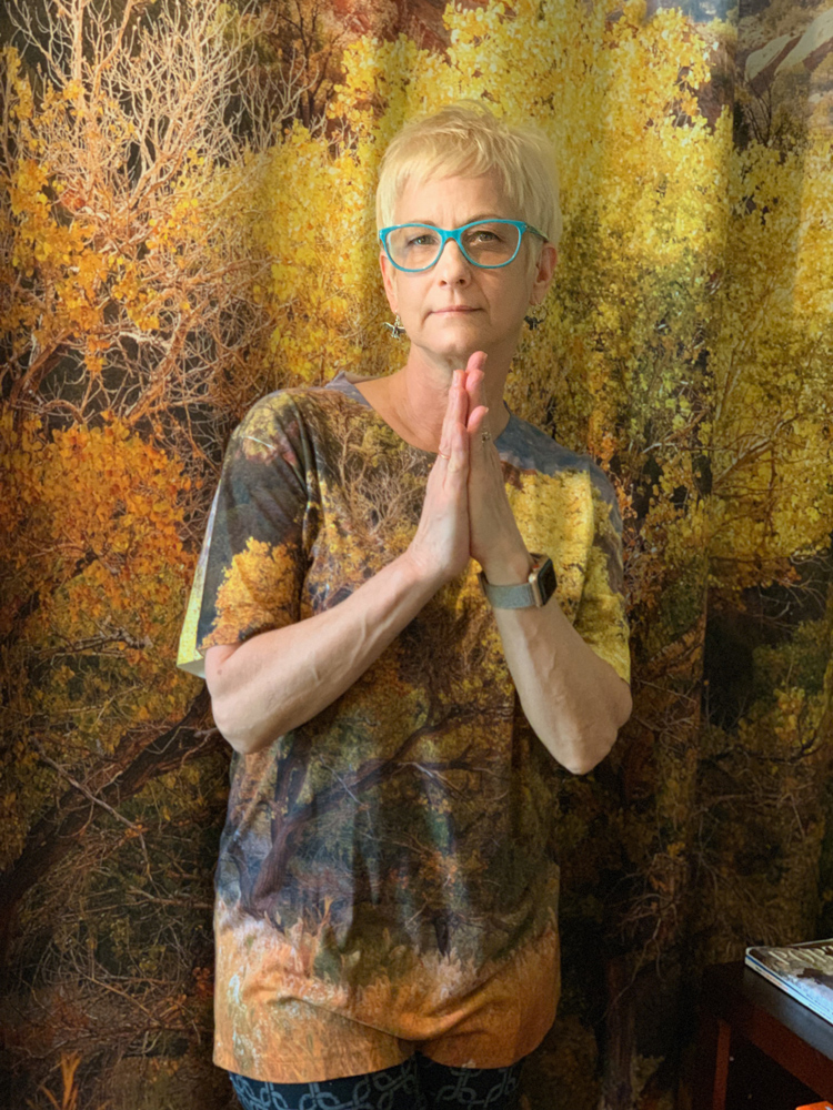 Debra in one of our t-shirts with the shower curtain as the background