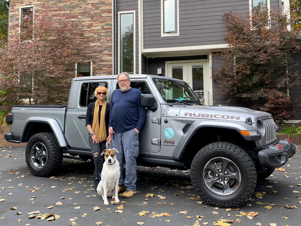 Debra, Kevin and our dog Maggie with our adventure Jeep Gladiator. We are a two jeep family.