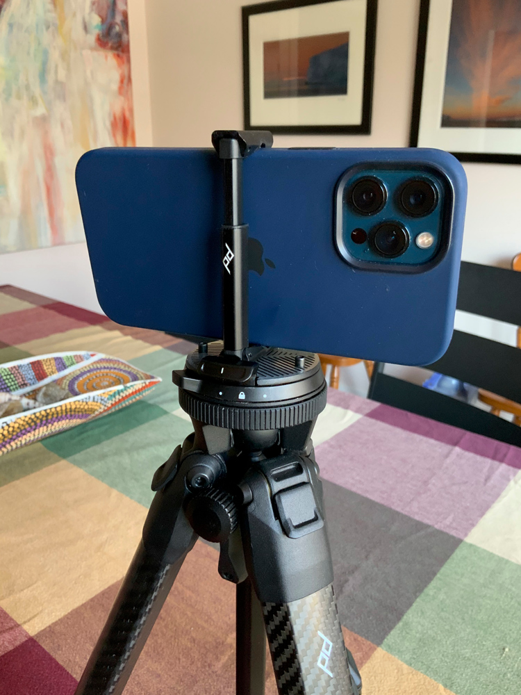 Using the iPhone attachment on the tripod. Even works with iPhone case attached.