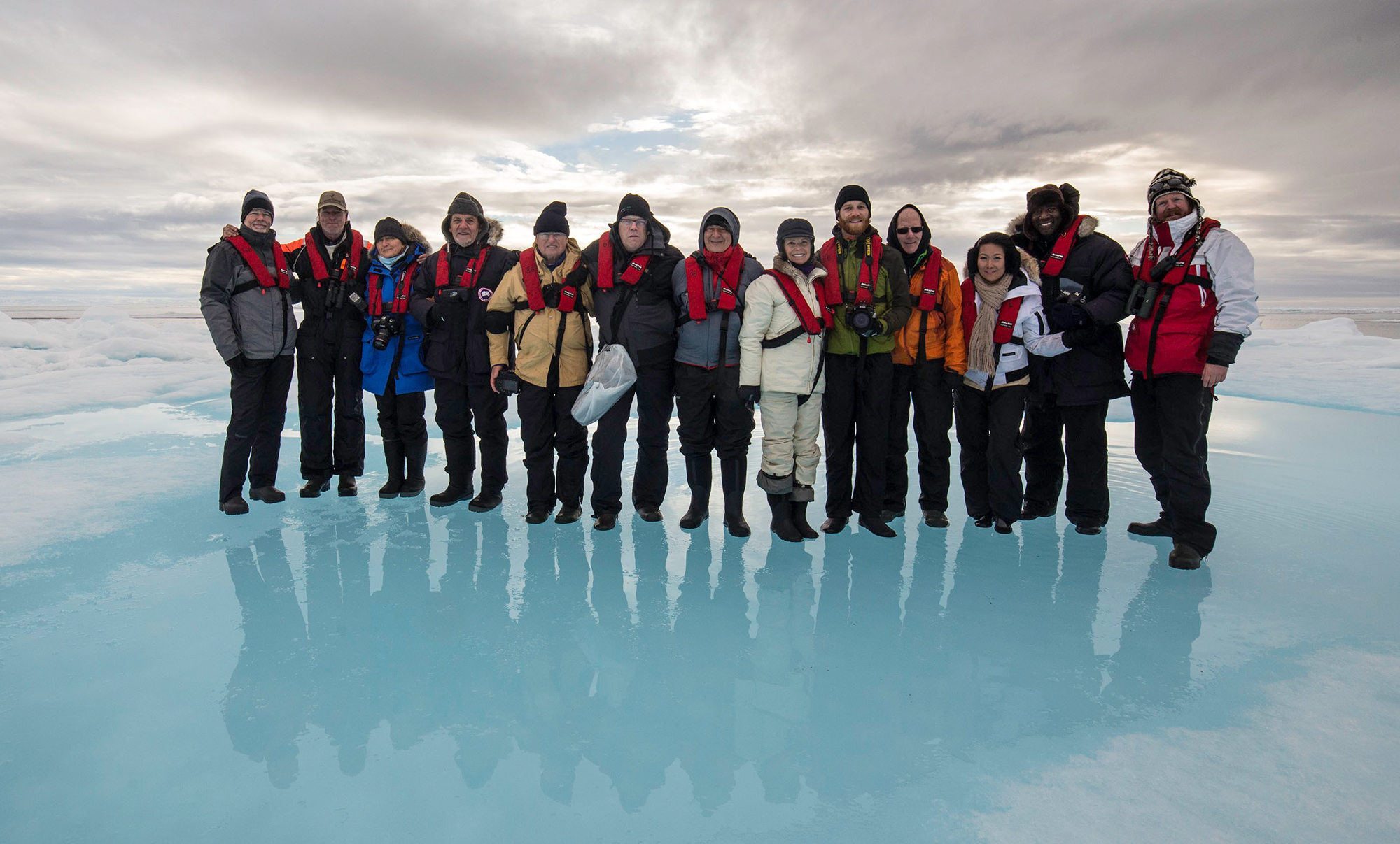 Group photo from a previous trip on an ice flow in the Arctic Ocean